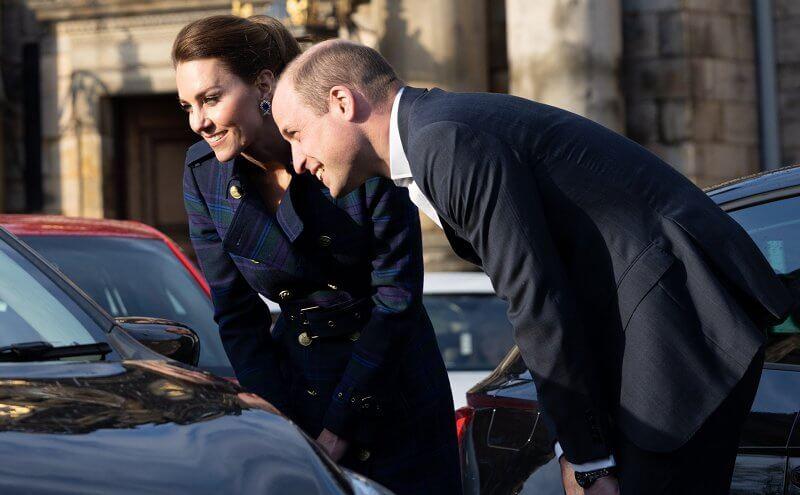 Kate Middleton wore a full length marlborough heather tartan trench coat  from Holland Cooper. Joseph metallic knitted skirt