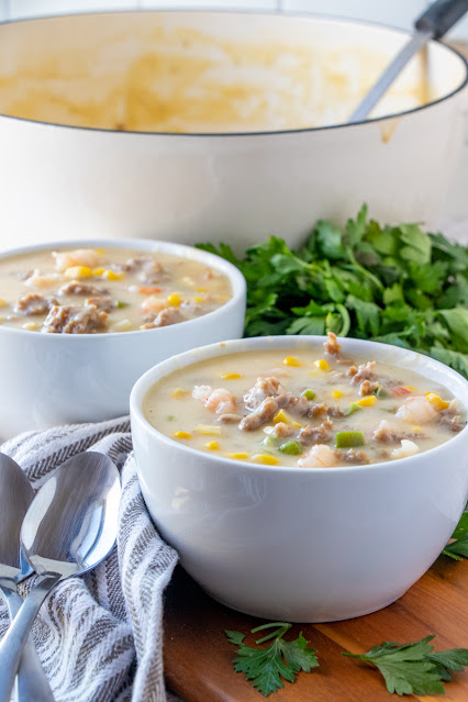 Two bowls of chowder with soup pot
