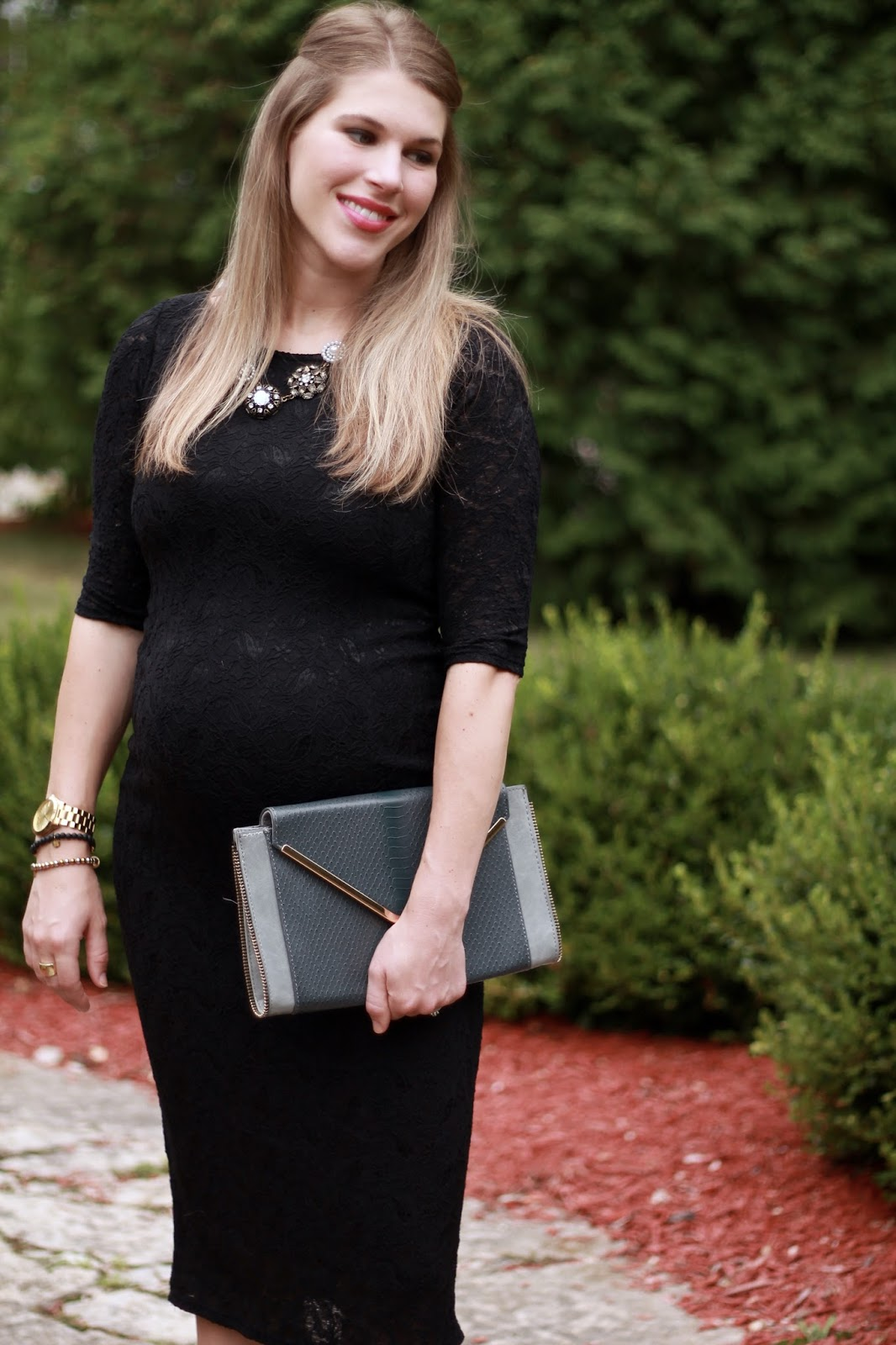 black lace maternity dress, green heels, grey clutch, vintage necklace, maternity wedding look