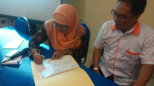 Penandatanganan MoU oleh Ketua PD. Aisyiah Jember dengan Direktur Lazismu Jember