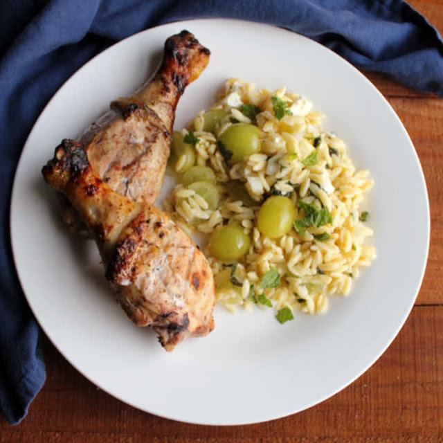 plate of lemon yogurt grilled chicken and grape and feta pasta salad