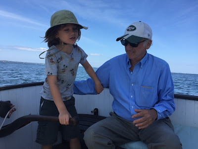 Fred and his grandson on a fishing boat