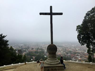 fog-enshrouded view of Antigua from Cerro de la Cruz