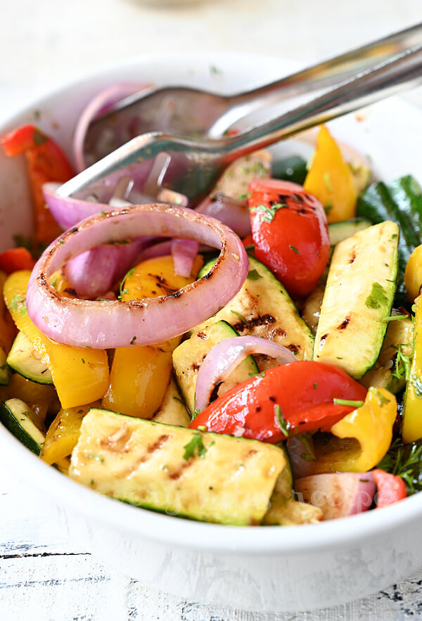 steps to make grilled vegetables garnished with chopped cilantro, parsley