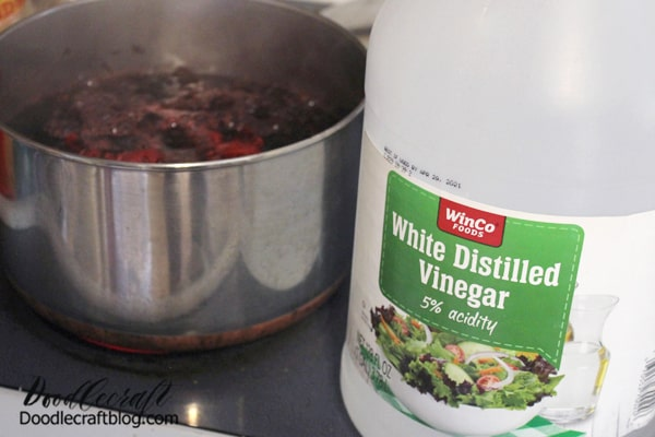 Begin by boiling the flowers using half the water on the directions. I used 3 cups of flowers and 2 quarts of water. It made a lot of dye!  Then add 1 tablespoon of White Distilled Vinegar per cup of water into the mix. Bring to a boil.