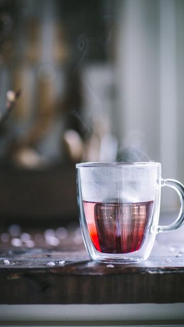 خلفية هاتف كوب شاي تصوير جميل