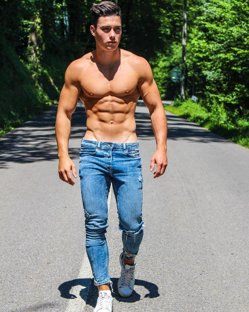 cute-shirtless-slim-fit-jeans-boy-walking-road