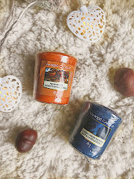 an orange and a blue candle
