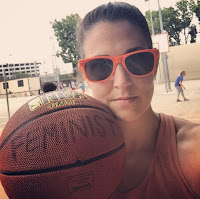 "Kate Spencer with basketball labeled ""feminist"""