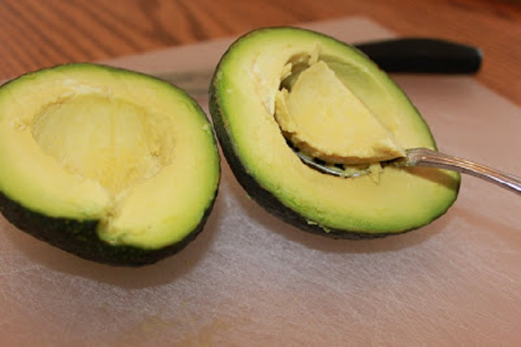 cutting and scooping out the avocado