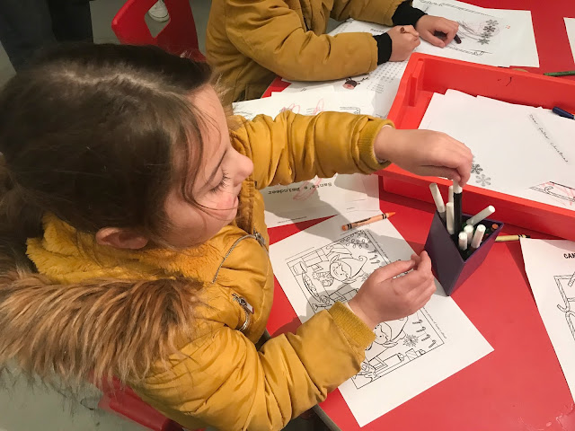 colouring whilst waiting to see Father Christmas at woodhorn