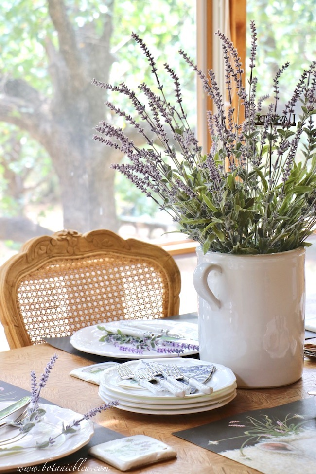 Whimsical Summer Lavender Tablesetting white crock and hand carved cane back French chairs
