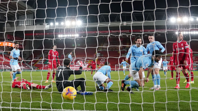 Man City midfielder Ilkay Gundogan scores against Liverpool