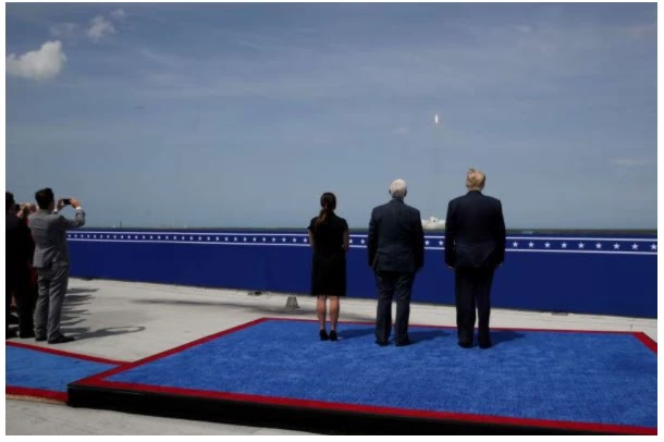 U.S. President Trump watches the launch of a SpaceX Falcon 9 rocket and Crew Dragon spacecraft, from Cape Canaveral, Florida
