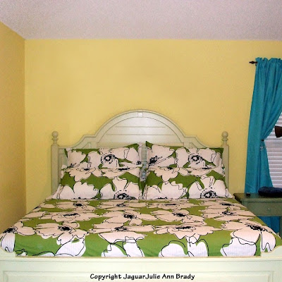 Green White and Black Floral Bedding in Master Bedroom