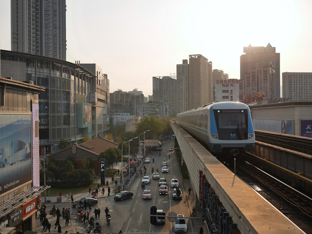 metro train arriving at Xunlimen Station in Wuhan