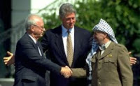 The famous handshake between Rabin and Arafat, with Clinton symbolically bringing the two together.
