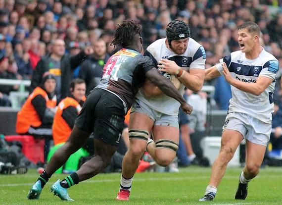 Gabriel Ibitoye of Harlequins tackles Lewis Thiede of Bristol