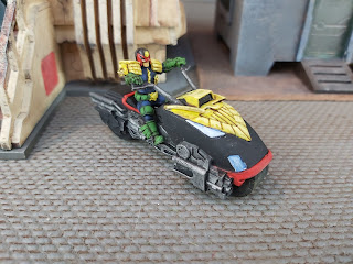 Judge Dredd rides his Lawmaster bike