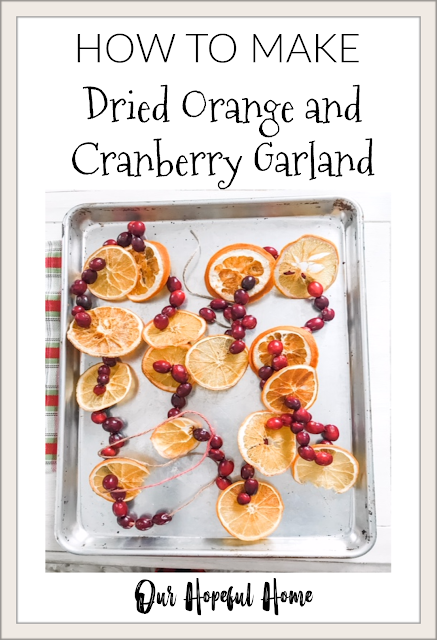 dried orange slices cranberry twine Christmas garland silver tray