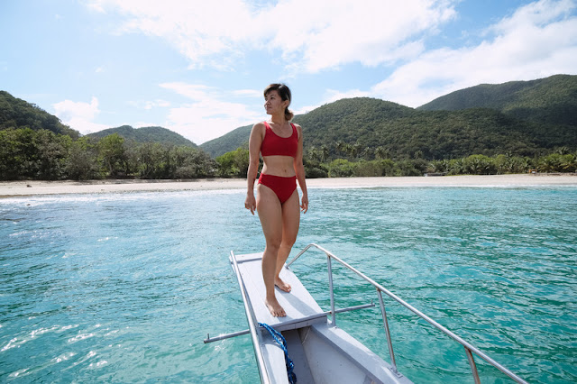Celine Murillo stands on a boat in Baler