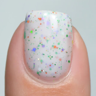white crelly nail polish with halloween glitter