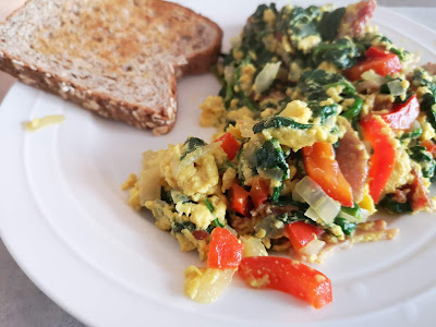 Scrambled eggs with spinach, red pepper, onions and bacon