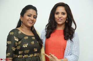 Actress Suma in Black Salwar Suit and Anusuya in orange Dress at winner movie press meet part 1 February 2017 (25).JPG