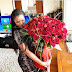 Emmanuel Adebayor surprises his girlfriend with giant bouquet of roses on Valentine's Day