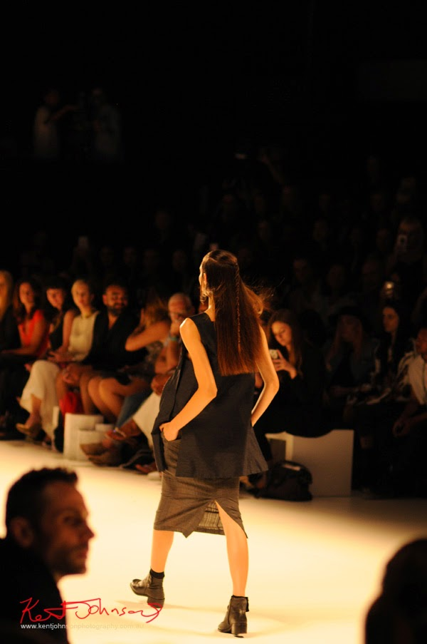 Back view, Womens long shift sleeveless top with a large relief circle motif,  Matiny Ng's 580 fashion label at MBFWA Raffles International Showcase, Carriageworks Sydney. Photographed by Kent Johnson.