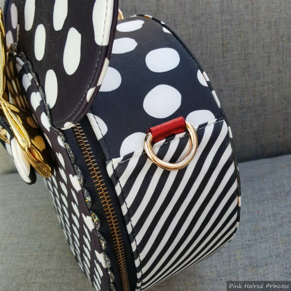 side of round handbag in black and white stripe and polka dots