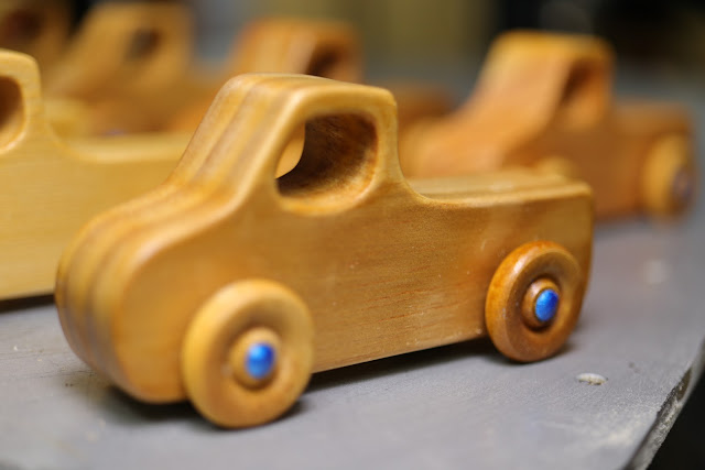 Handmade Wooden Toy Pickup Trucks Ready For Final Inspection