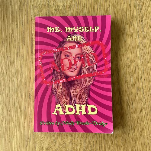 pink stripey cover of me myself and adhd, showing line drawing of the writer, Molly's head and hair, with text title of book
