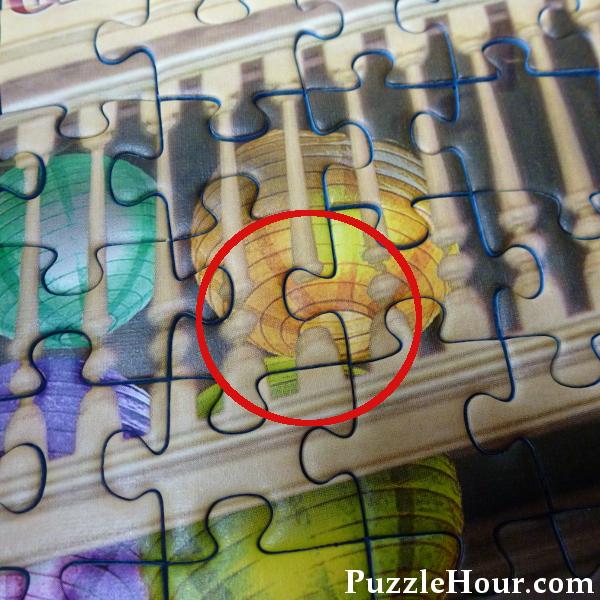 Fantasy bookshop Ravensburger jigsaw puzzle detail showing a digital art error mistake