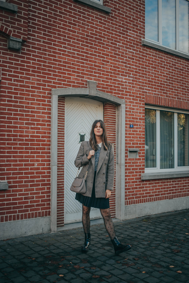 fall outfit with pleated skirt, blazer, polkadot tights and platform boots