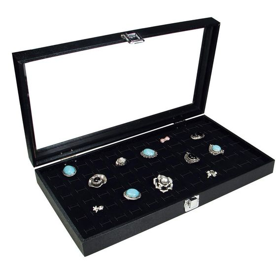 A wooden ring case with clear glass top.