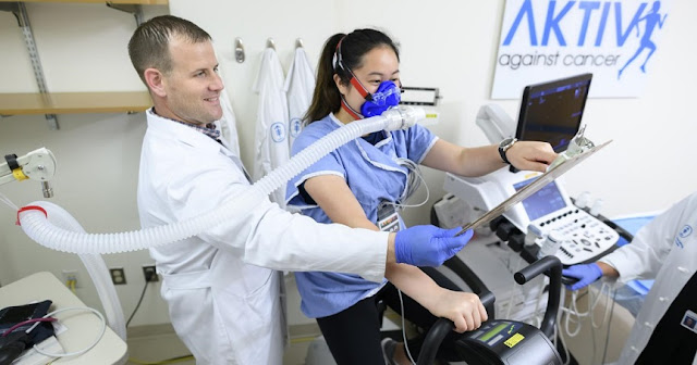 This picture shows Memorial Sloan Kettering Exercise Physiologist Dan Townend conducts a cardiopulmonary exercise test to assess cardiorespiratory fitness on Catherine Lee. Credit: Memorial Sloan Kettering Cancer Center