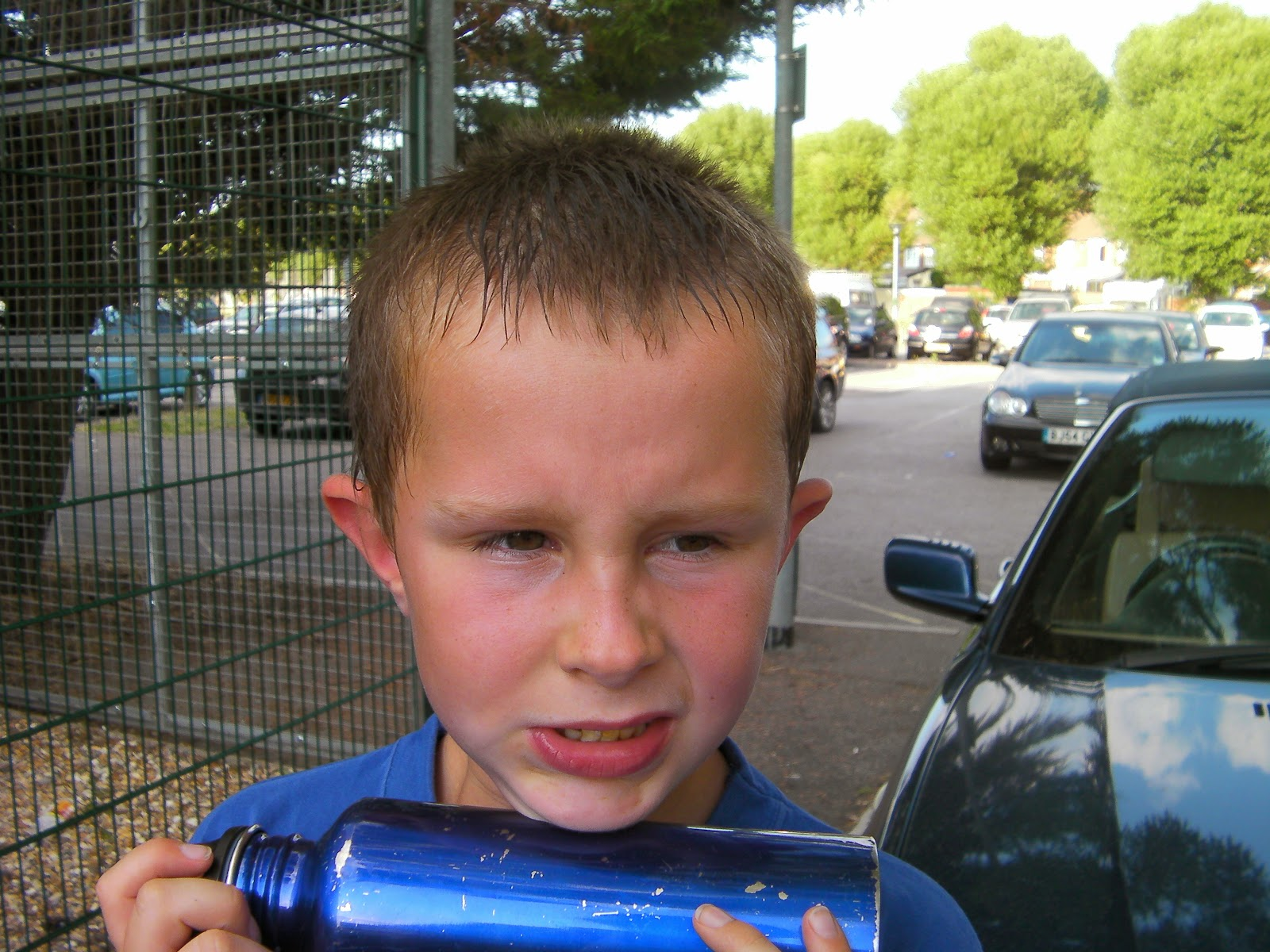 kid with water bottle outside portsmouth gymnastics centre