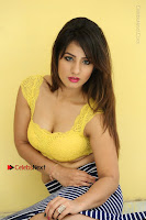 Cute Telugu Actress Shunaya Solanki High Definition Spicy Pos in Yellow Top and Skirt  0233.JPG