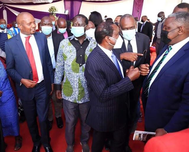 Gatundu South MP Moses Kuria with Raila Odinga photo