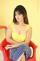 Cute Telugu Actress Shunaya Solanki High Definition Spicy Pos in Yellow Top and Skirt  0436.JPG