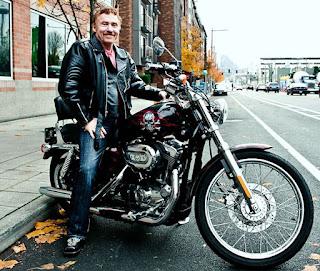 Railsback's hubby Danny Bonaduce sitting in a bike
