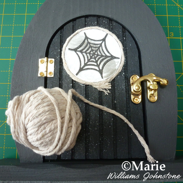 Adding a surround to the altered art door window using string