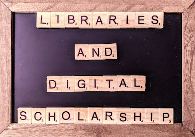 "A chalk board with scrabble tiles that reads ""Libraries and Digital Scholarship"""
