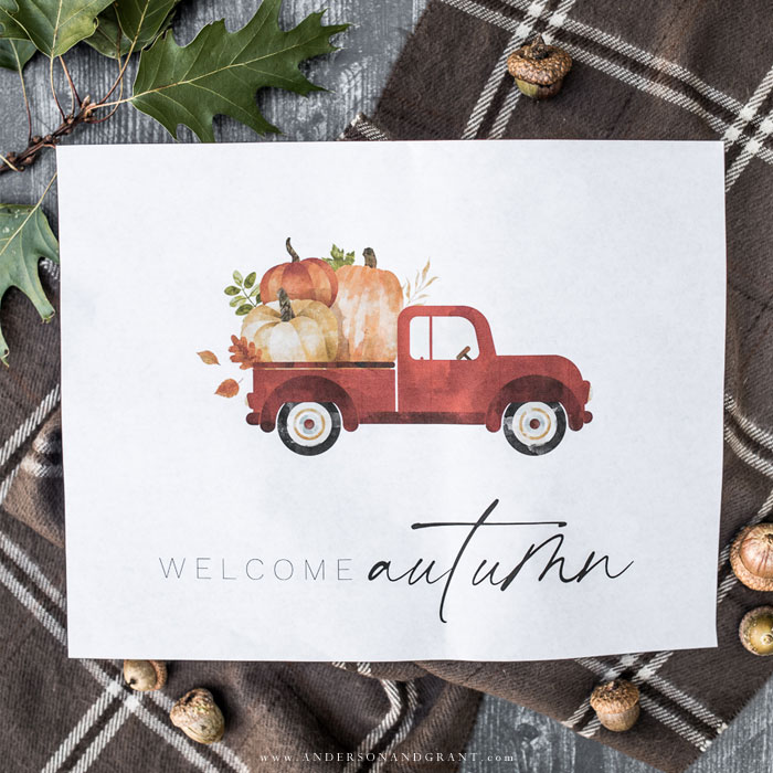 Red truck with pumpkins printed on white paper