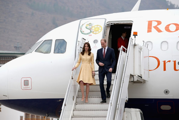 Prince William, Duke of Cambridge and Catherine, Duchess of Cambridge arrive into Paro International Airport for the first day of a two day visit to Bhutan. Kate wore Emilia Wickstead soft-yellow gold bespoke coatdress