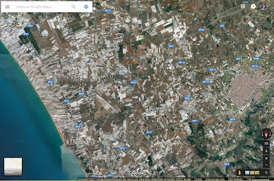 Satellite map of the area Vittoria Sicily showing greenhouse structures.