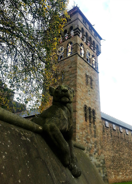 Leopard statue with Cardiff Castle in background