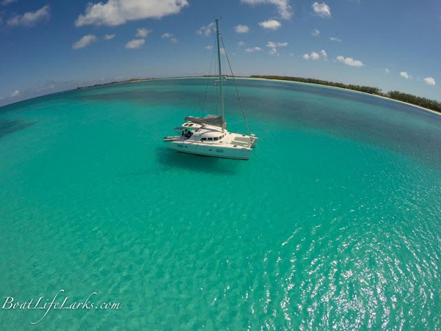 Boat at anchor, shelling beach, Great Harbour Cay, Berry Islands, Bahamas