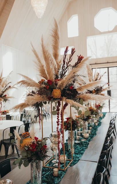 Fall Wedding Reception with tall pampas grass centerpieces